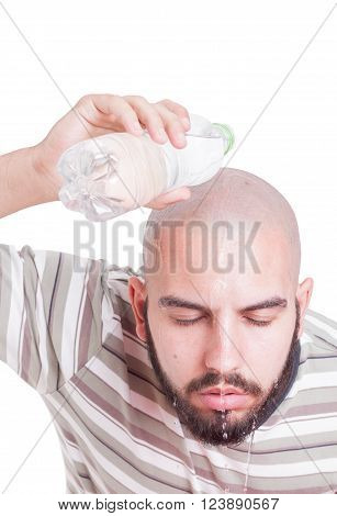 Man cooling by pouring water over head in summer heat. Hydration or dehydration on heatwave concept
