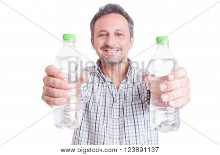 Man giving or offering two bottles of cold water. Stay hydrated during summer heat concept