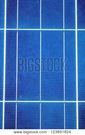 Close-up with blue solar panel cells as renewable energy concept