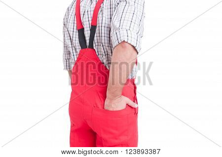 Man Holding Hand Inside Back Pocket Of Rompers Or Coveralls