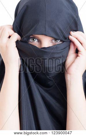 Beautiful muslim woman wearing burka on white background