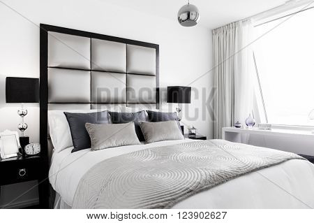 Modern designer bedroom in a beautiful apartment house