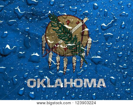 a flag of Oklahoma with rain drops