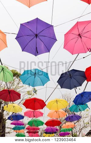 Colorful Umbrella Hanging On The Rope