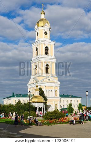 DIVEEVO RUSSIA - AUGUST 22 2015: Unidentified pilgrims are on the territory of the Holy Trinity Seraphim-Diveevo monastery near the bell tower the village of Diveevo Russia