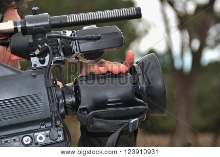 Videographer with professional camera taking a shoot. Cameraman