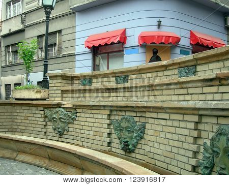 historic wall sculpture fountains in Bohemian section Skadarlija Belgrade, Serbia, Europe