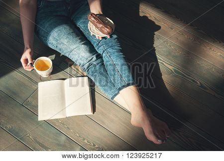 Cozy Photo Of Young Woman With Tea And Cake Sitting On The Floor