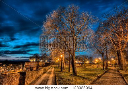 view at night of the medieval Medici Fortress (italian: Fortezza Medicea) in Siena, Tuscany, Italy