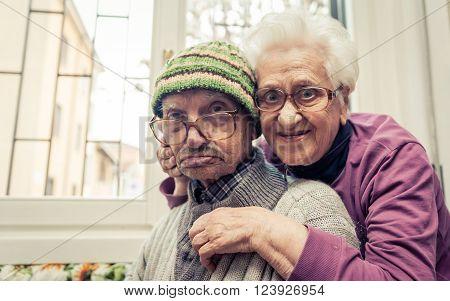 old couple portrait. grandparents posing for a family portrait