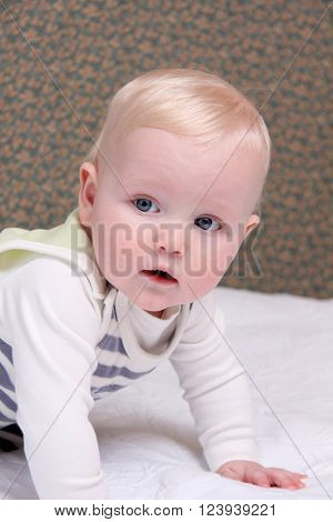 Closeup six month old baby blonde boy
