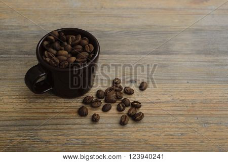 cup and coffee beans on a wooden table