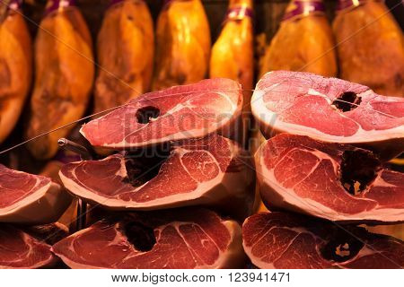 Iberico cured jamon on the market stall in Valencia Mercado