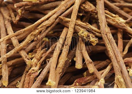 Licorice root sticks lie on a wooden table