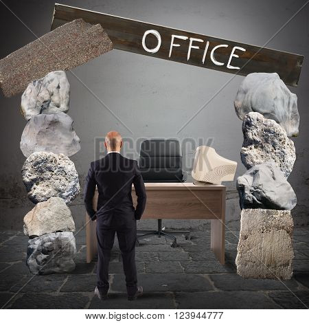 Man looks at an office with rocks