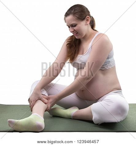 Pregnant sitting woman and spasm on white background