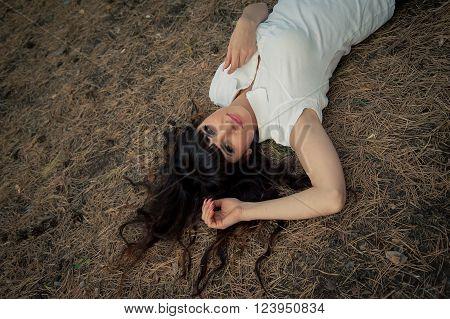 beautiful brunette woman posing looking at camera