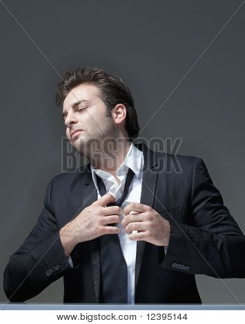 Businessman Loosening Tie