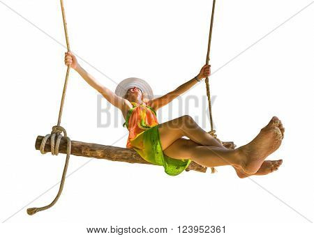 Happy and attractive woman with colorful sarong and white wide-brimmed hat swinging.  Isolated on white background.