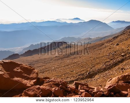 Tourists descend from the Mount Sinai after the night hike to the summit of Aka Jebel Musa, Sinai Peninsula in Egypt. poster