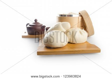 Pao Or Dim Sum In Bamboo Steamer With Chinese Bun.