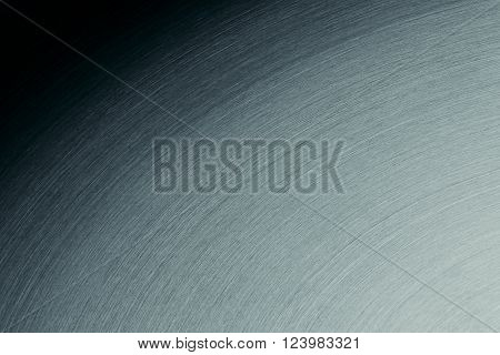 The steel surface with the semicircular lines. The gradient background.