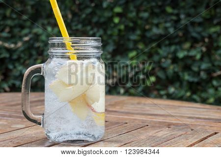 Glass of iced apple soda drink, stock photo
