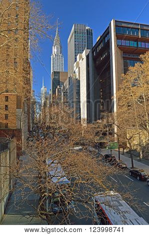 New York City, USA - December 15, 2015: NYC streets. Midtown Manhattan - 42nd Street with Chrysler Building.