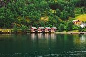Red Wooden Docks In Town Of Flam, Western Side Of Norway Deep In Fjords. Forest And Water Background. Copy Space. Sognefjord Port poster