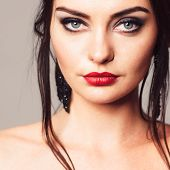 Young attractive woman with bright and bold make-up. Contrast girl with bright and bold make-up. Portrait of contrast brunette. poster