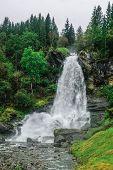 Norway Hordaland county. Famous Steinsdalsfossen waterfall. Scandinavian nature. poster