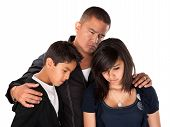 Hispanic father with kids looking down and sad on white background poster