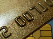 golden credit cards close-up shallow depth of field poster