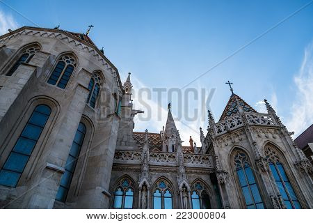 Budapest, Hungary - August 14, 2017:  Matthias Church. It is a Roman Catholic church located in front of the Fisherman's Bastion at the heart of Buda's Castle District. Sunny day of summer
