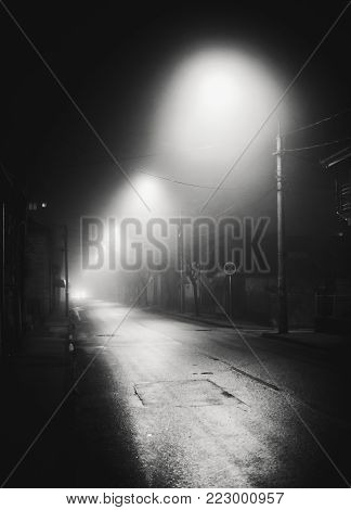Night scene from small Balkan town, foggy atmosphere.