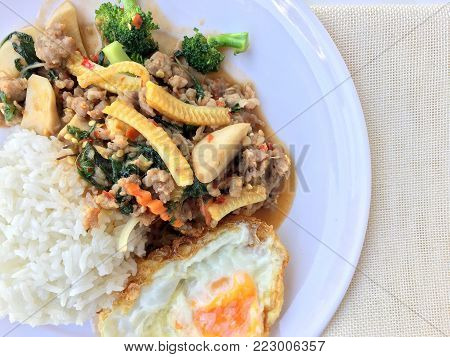 Stir Fried Minced Pork With Basil Eating With Rice And Fried Egg On White Background. Thai Food.