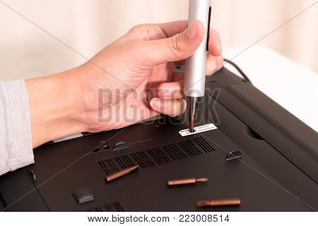 the void of warranty after women repair laptop using screw driver, repair and maintenance