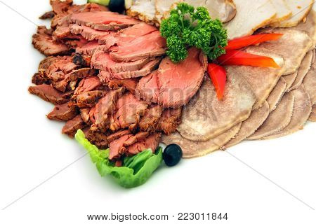 Meat delicacies - roast beef, tongue beef, cold boiled pork. Isolated on white background.