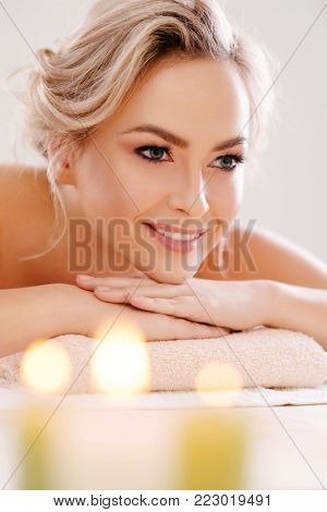 Young, beautiful and healthy woman relaxing in spa salon. Rejuvenation therapy and massaging treatments. Recreation concept.