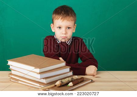 Young Boy Looking Angry Shaking His Fists Tired Of School Lessons, Education. Tiredness Stressing Ov