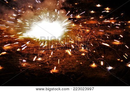 blasting of cracker into small flames and the sparking light