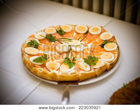Pattern Arrangement of coffee break snack in complete set ready for participants after meeting, seminar, workshops, conference, catering on white table, deep fried dumping, cake, fruit, grill salmon