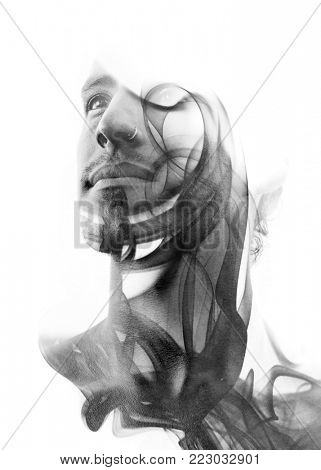 Black and white, unique conceptual work bringing together the unpredictable nature of smoke with the firm gaze of a young attractive man