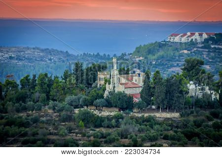 ABU GHOSH, ISRAEL. November 24, 2017. A view of the Benedictine monastery in Abu Ghosh at the sunset.