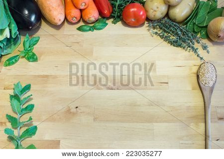 Healthy Food concept with vegetables, herbs and spoon on wooden background. Empty space for text, design and decor. Preservative-free vegetarian and vegan cooking diet, weight loss.