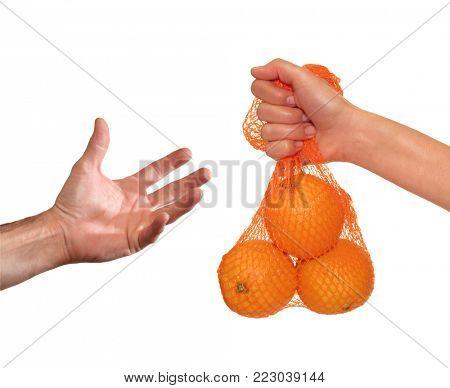 Hand give an orange fruit bag.