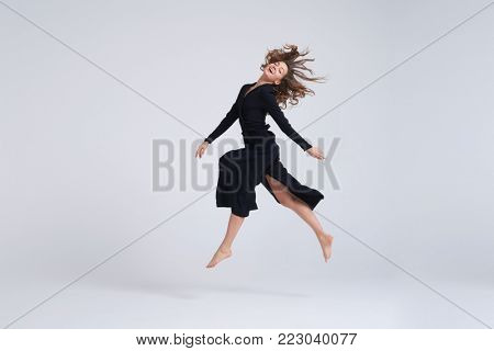 Full-length shot of young attractive woman hovering in the air