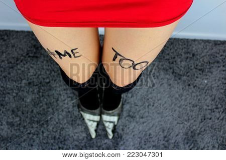 METOO - Sexy woman with inscription `me too`/Woman dressed in  red skirt and black stockings with inscription me too .
