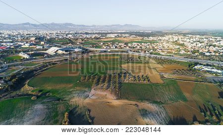 Nicosia, Cyprus - 12/25/2017: Aerial bird's eye view of GSP football stadium, highway A1 and round about at Latsia. The soccer field, athlete track of Pancyprian Gymnastic Association Stadium from above