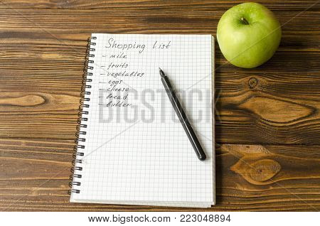 Preparing the shopping list before going to buy the groceries